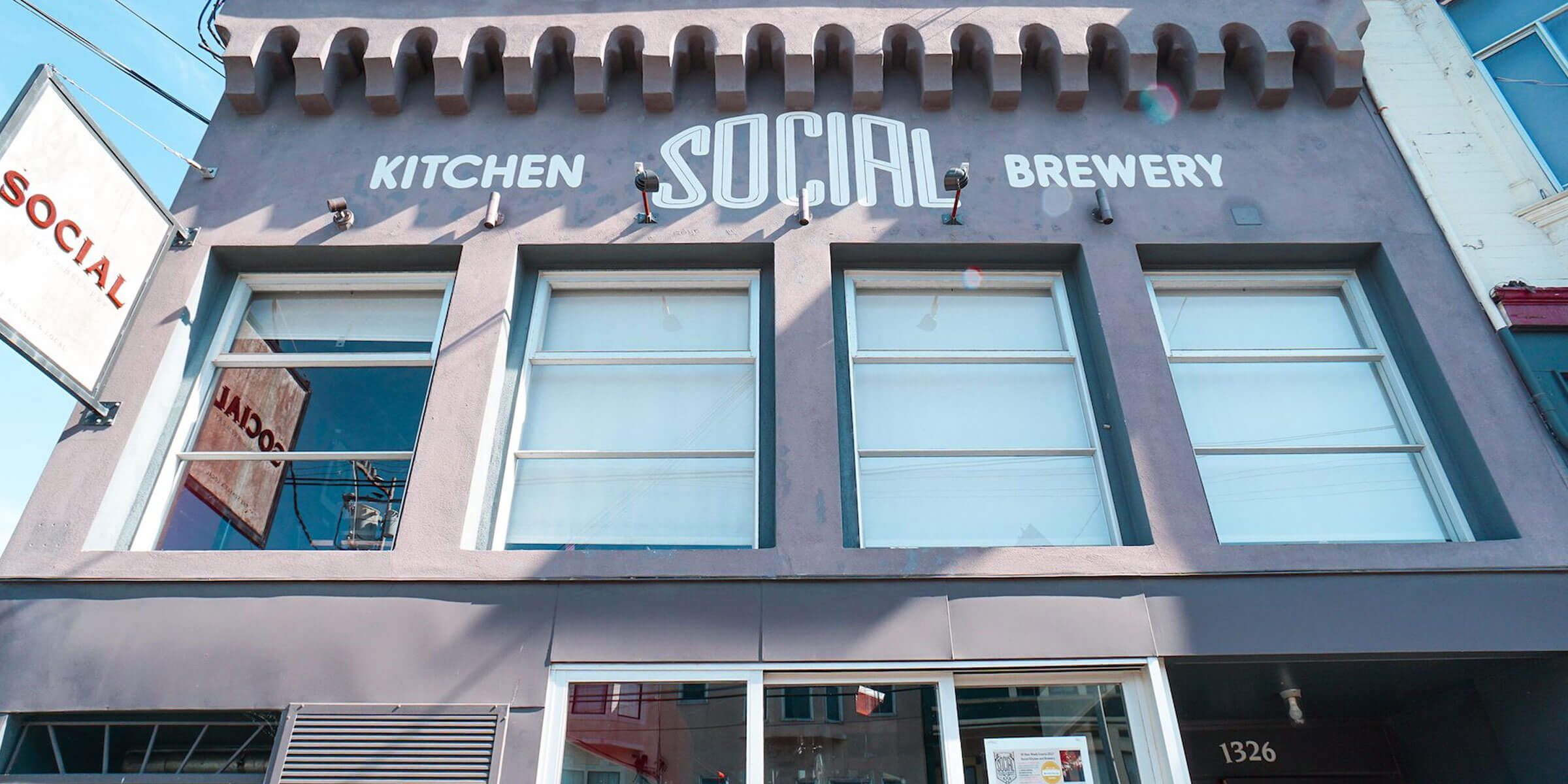 Signage above the entrance to Social Kitchen & Brewery in San Francisco, California