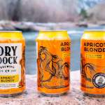 Thumbnail of http://Redesigned%20cans%20of%20the%20Apricot%20Blonde%20by%20Dry%20Dock%20Brewing%20Company