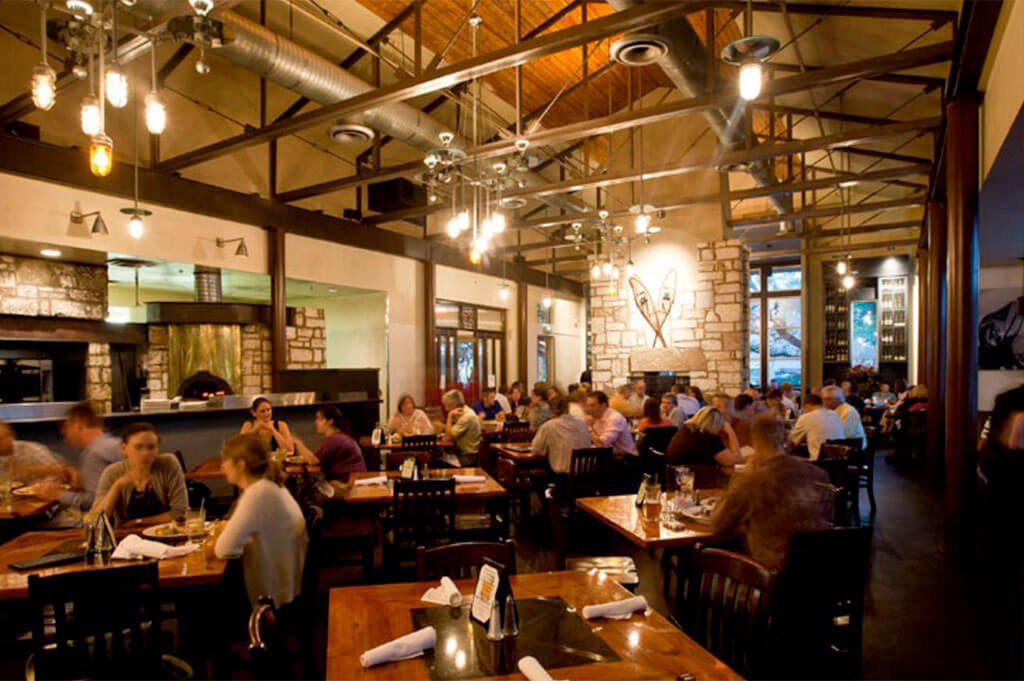 Inside the dining area at North By Northwest Restaurant & Brewery in Austin, Texas