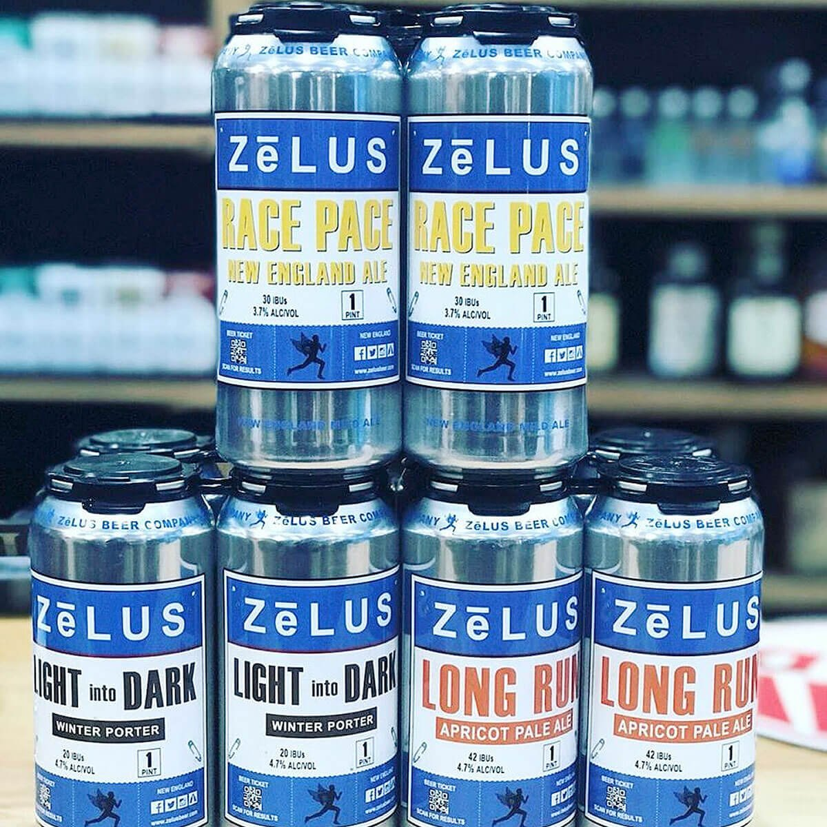 Stacks of canned beers offered by ZēLUS Beer Company