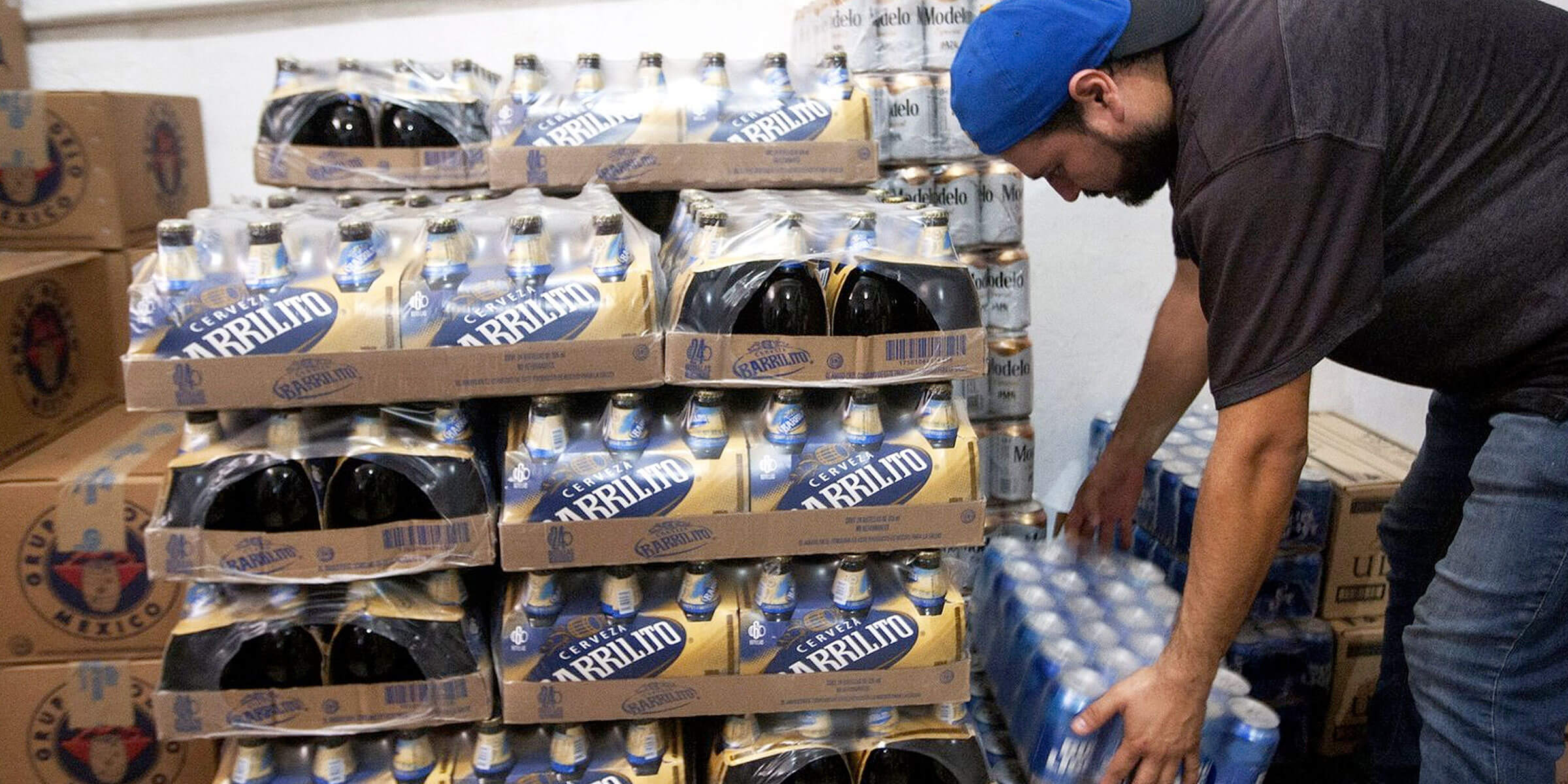 A man picks up a case of beer at a shop in Monterrey, Nuevo Leon state in Mexico