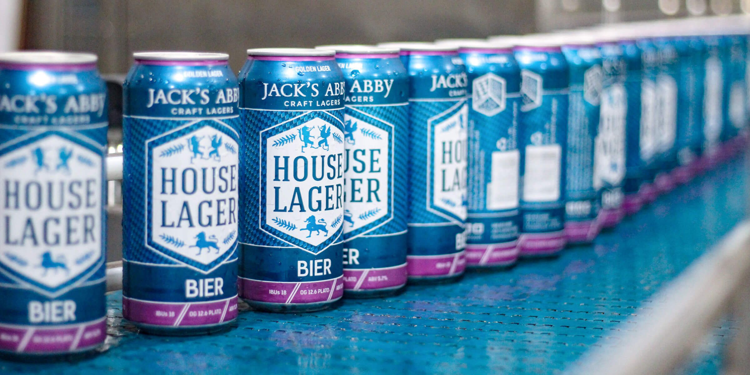 A row of 16 oz. cans of the House Lager Bier by Jack's Abby Craft Lagers