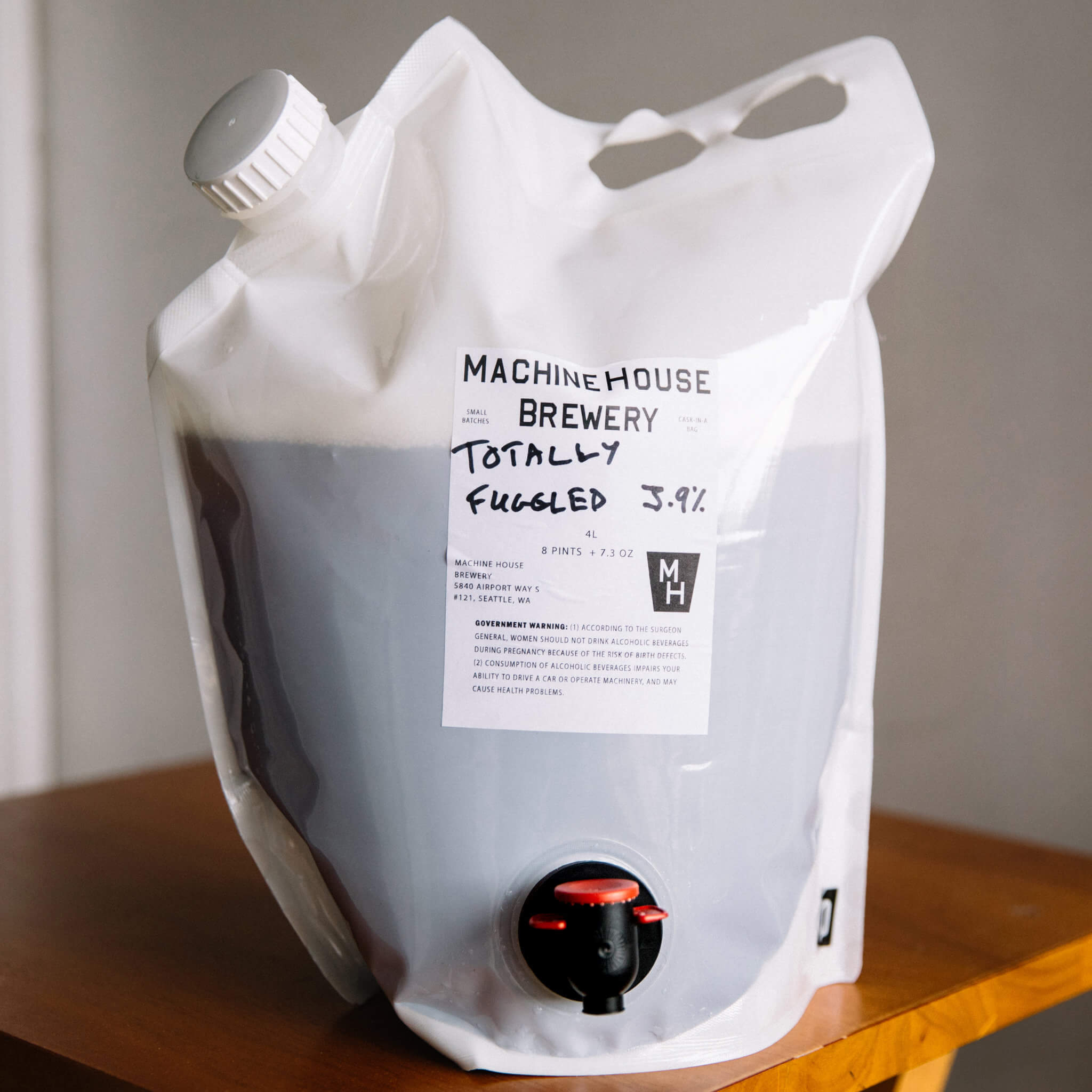 Machine House Brewery, a Seattle brewery that specializes in English-style cask-conditioned ales, began selling five-liter bags-in-boxes of its beer, which are lower in carbonation than traditional draft beer.