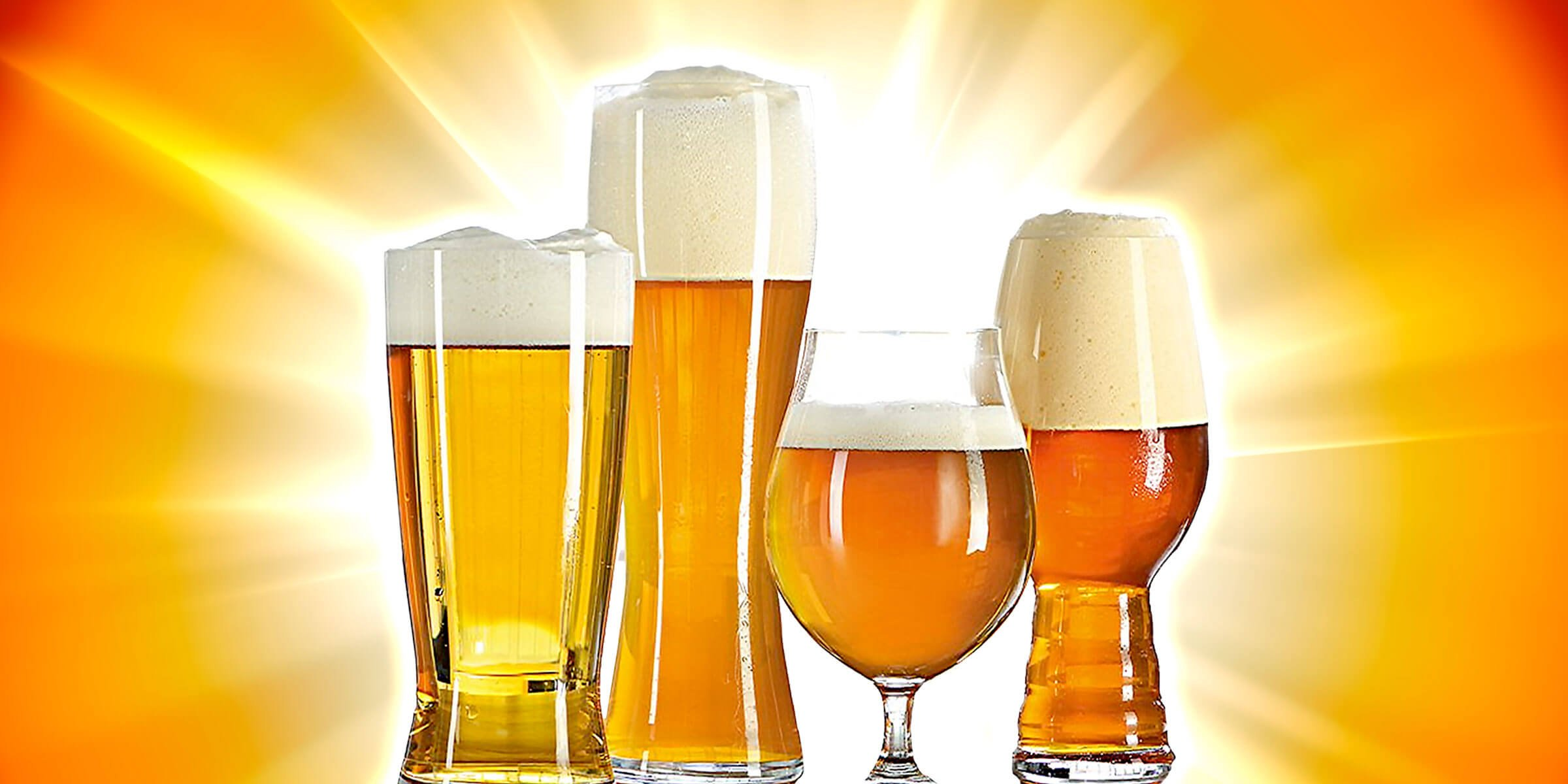 A quartet of golden beers set against a warm yellow-orange burst background