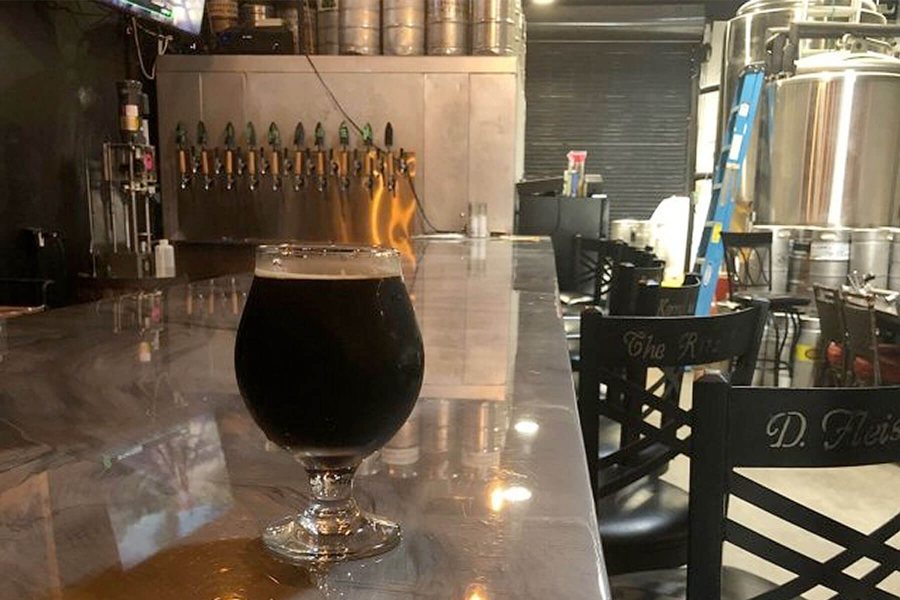 Inside the taproom at Black Flamingo Brewing Company in Pompano Beach, Florida
