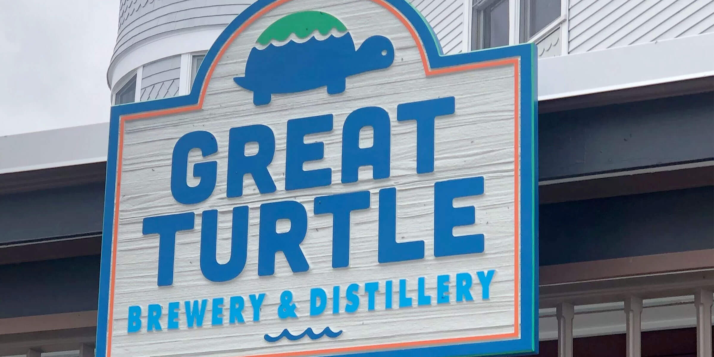 Signage posted above the entrance to the Great Turtle Brewery & Distillery on Mackinac Island, Michigan