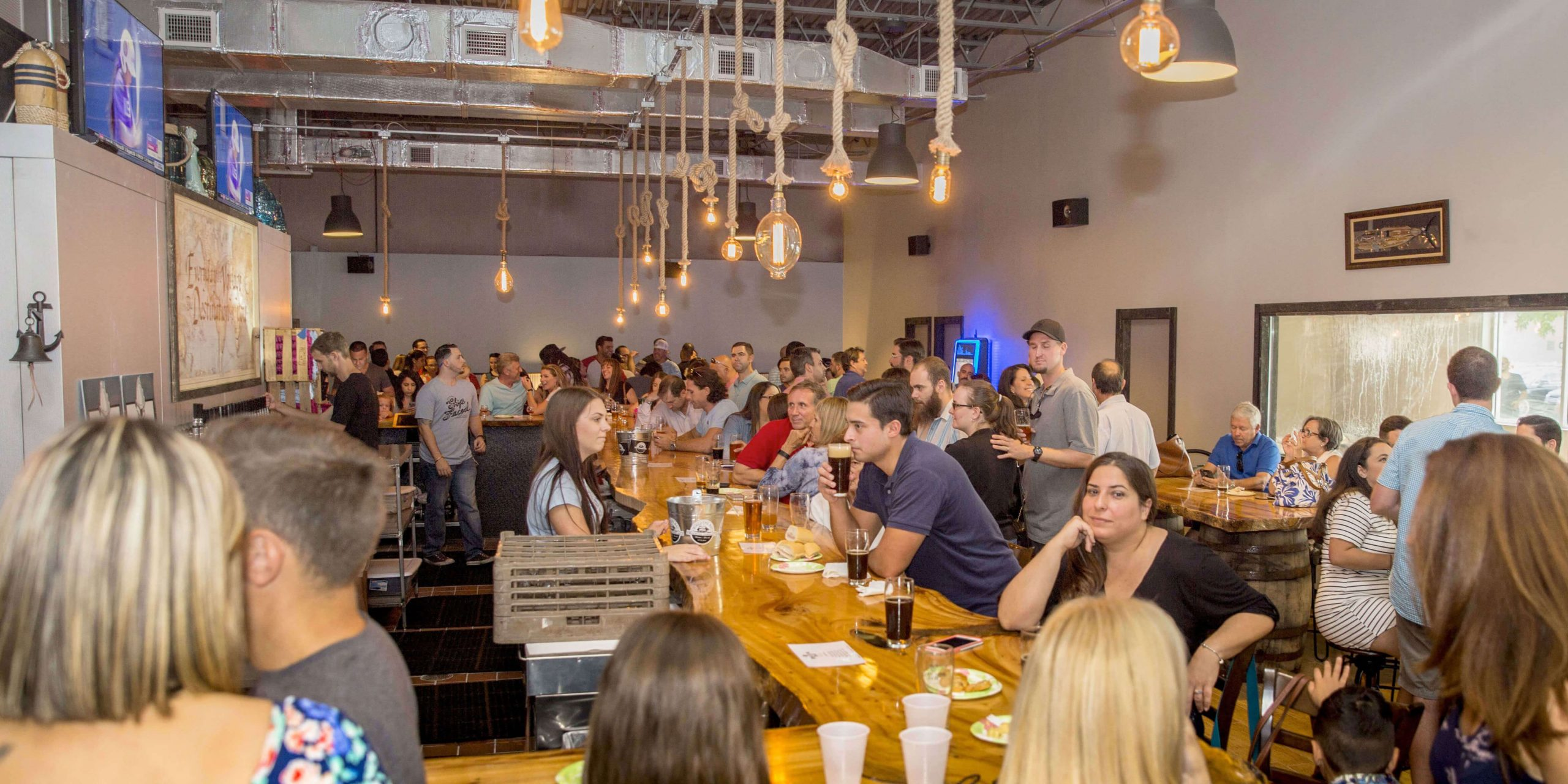 Inside the Biscayne Bay Brewing Company taproom in Miami, Florida