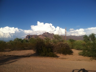An image of cumulus storm clouds forming over Superstition Mountain. Monsoons bring nourishment for summer pests in the Phoenix area.