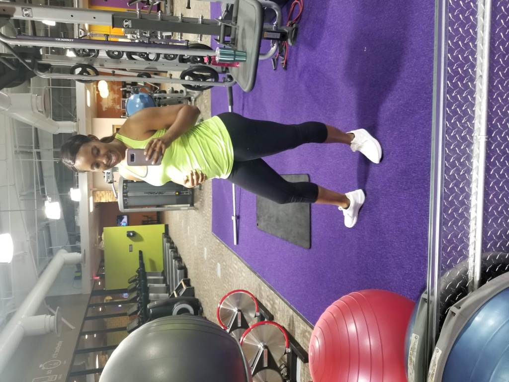 First Trimester fitness photo in a gym setting