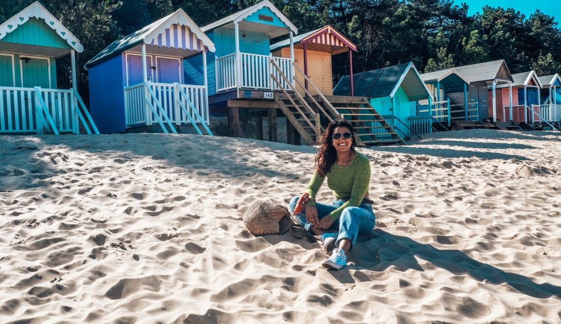 How to save money when you travel with Absolutely Lucy, featuring Wells beach and beach huts
