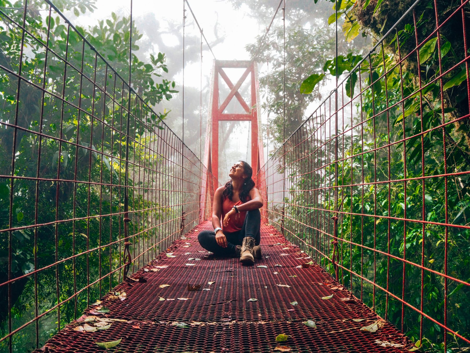 Lucy sitting on the Hanging Bridge at Monteverde