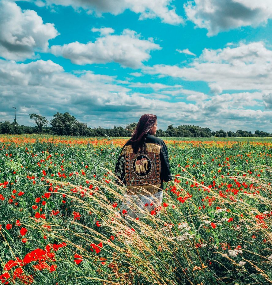 Mindfulness and meditation, girl in elephant jacket, poppy field