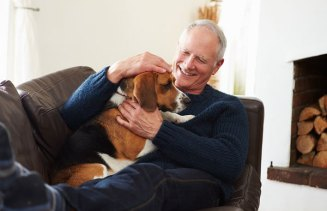 man at home relaxing with dog