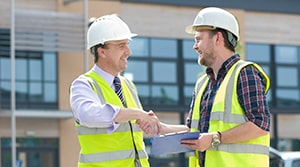 Two Roofers Shaking Hands