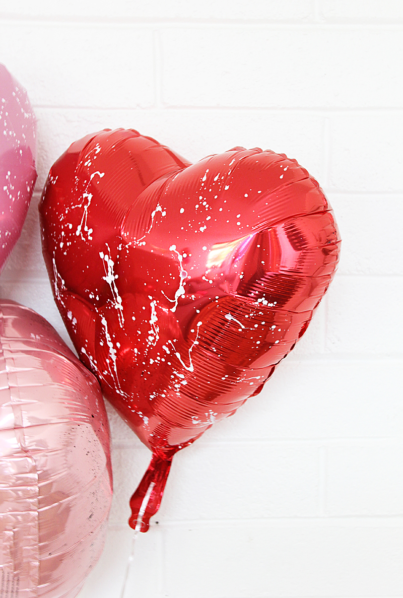 red heart balloon with white paint splatter