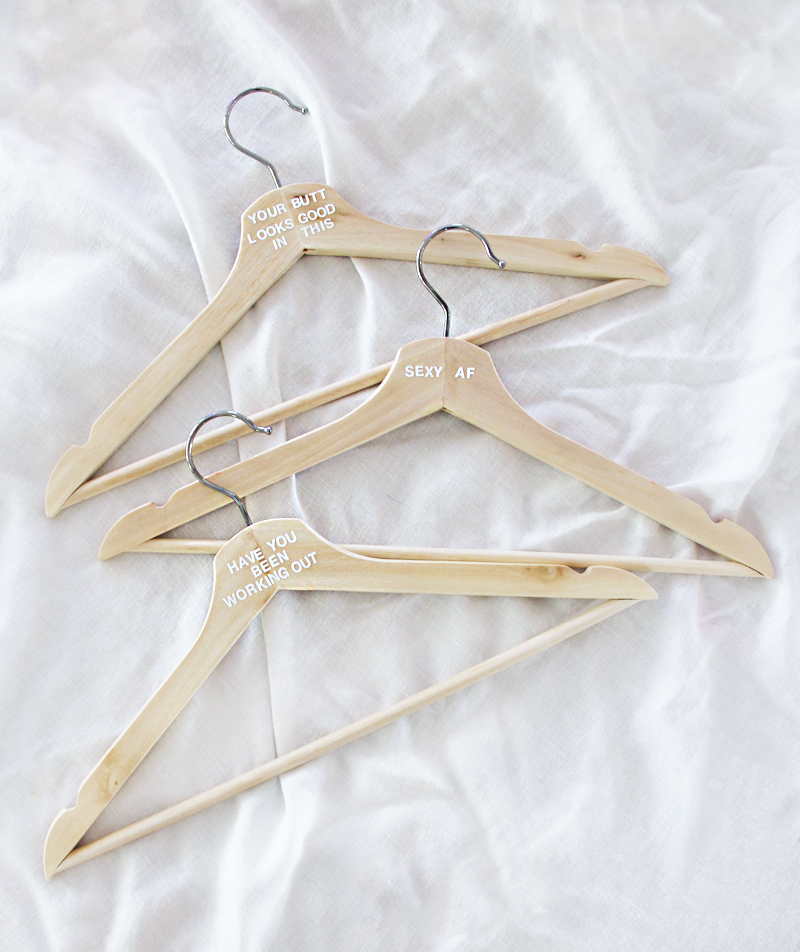 hangers with compliments stickered on them