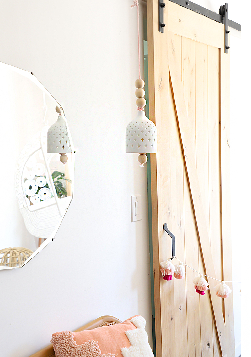 ceramic bell in front of closet door and mirror
