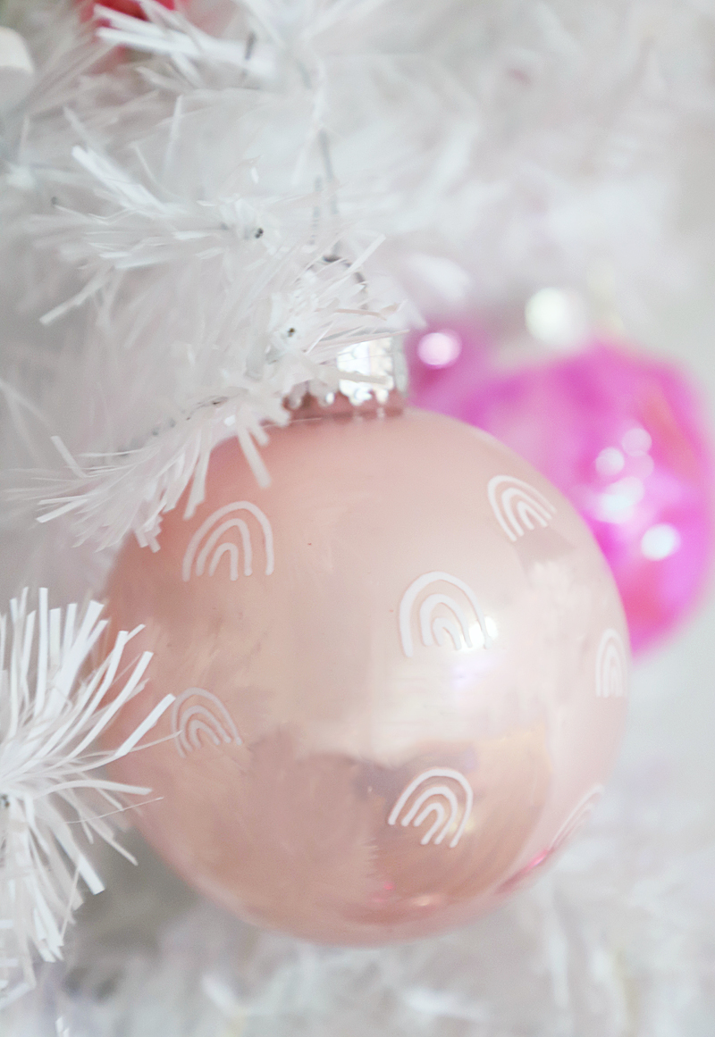 pink ornaments with white rainbows