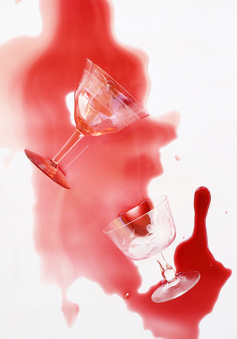 dropped martini glasses with red liquid