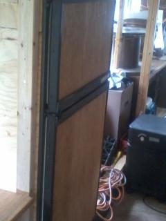 Oak facing on the fridge (and freezer) doors.