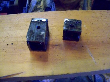 The connector cups, fitted and drilled to be attached to the actuator.