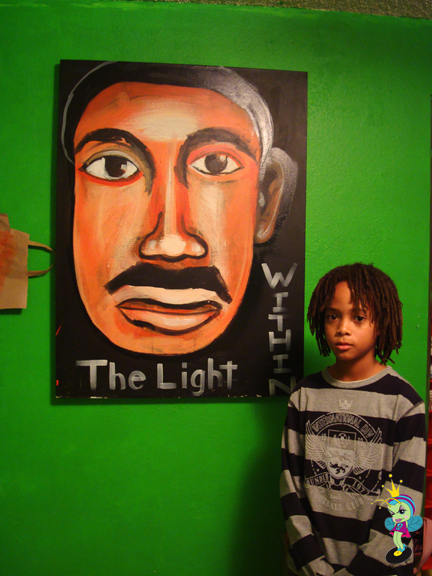 """Baqi (the artist) with his painting """"The Light Within"""""""