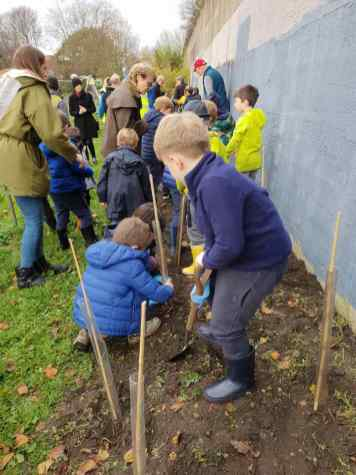 Tree planting 200 trees 200 children next to wall