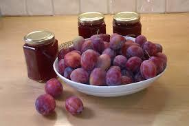 Plum jam jars and plums