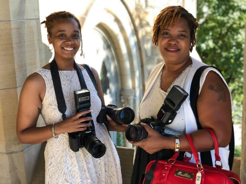 Abyrdseyephoto Productions Photography Owner Ambershaun Byrd and 2nd shooter Angela Byrd posing at a Toledo, Ohio wedding.