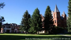 Brick buildings and evergreen trees on campus of U. of Montana Western.