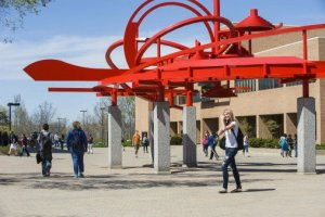 Red abstract sculpture, called Turning Points on campus of Wright State University.