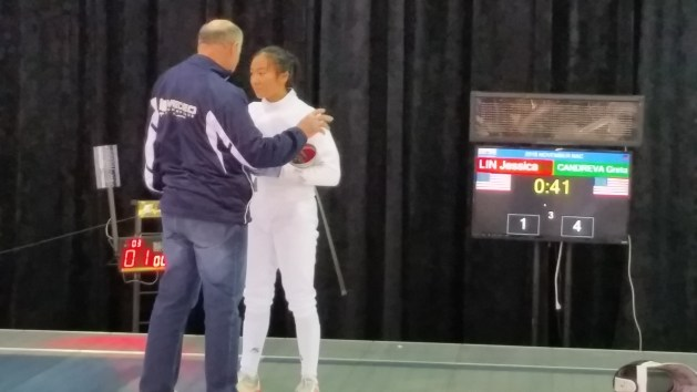 Yakov Danilenko coaching Jessica Lin at the final strip at November 2016 NAC in Milwaukee
