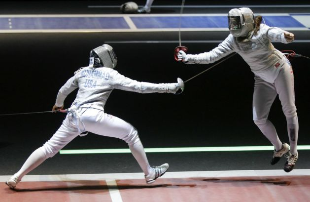 Can You Die from Fencing? Sabre Fencer lunges at another, both are wearing visor fencing masks
