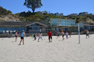 AFM fencers play beach volleyball during summer fencing camp