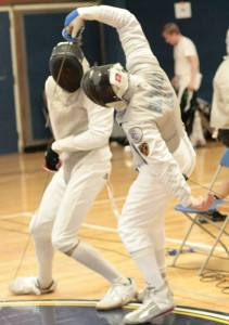 Alan Buchwald (veteran foil fencer) scores a touch at competition