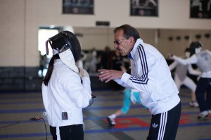 Coach explains few points to his fencer during a bout