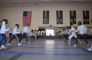 Fencers start the fencing bout at Academy of Fencing Masters