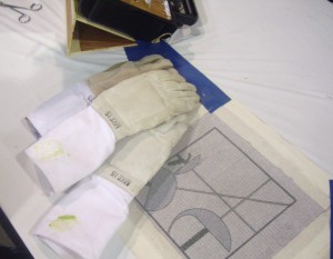 Fencing equipment check - gloves will be checked and stamped at regional and national fencing tournaments