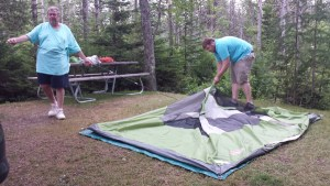 Bill Mulvey of Phoenixville, Pa. and his son, Pat Mulvey, pitch their tent at the Schoodic Woods Campground.