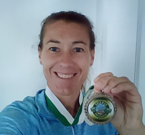 Jennifer VanDongen of Bar Harbor came in first in the inaugural virtual 100-mile Acadia Centennial Trek, by completing the race in just 8 days. She earned that medal!