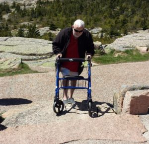 Carlos Kjellander of Pittsburg, Kansas uses a walker on the Cadillac Mountain summit at Acadia National Park