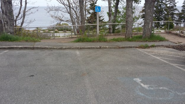 Accessible parking is adjacent to a ramp that leads from the lot at Thunder Hole, across Ocean Drive, to a viewing platform above Frenchman Bay.