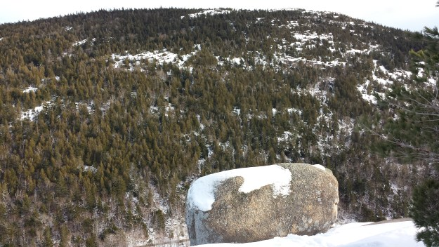 Bubble Rock is capped with snow during winter in Acadia National Park.