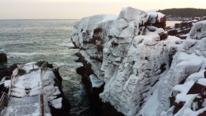 Icicles and windblown-snow cover the cliffs of Thunder Hole in Acadia National Park.