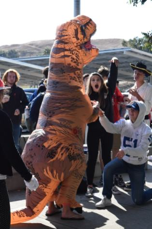 Sophomore Camryn Langley poses as a football player, and proposes to fellow dinosaur and classmate Maddie Wilson. Fortunately, the age difference is only a few million years.