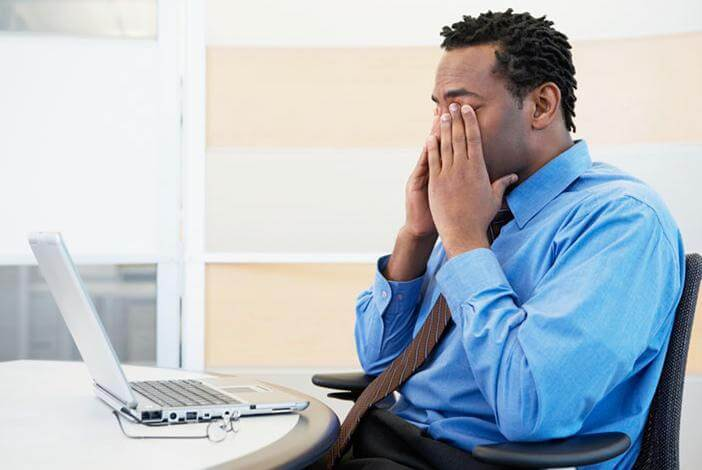 Man with aching eyes because of computer strain