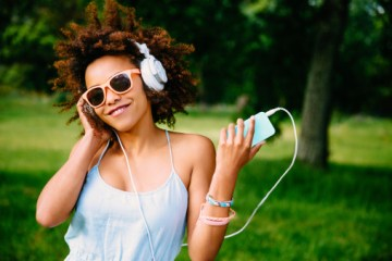 Young woman enjoying music on headphones