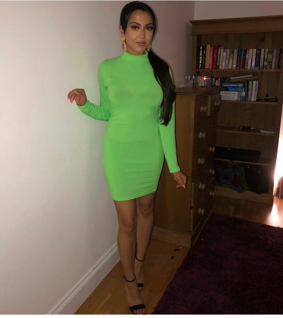 Image of a girl wearing a neon green dressing.