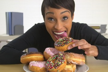 woman eating doughnuts