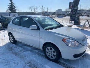 2010 HYUNDAI ACCENT Front Side
